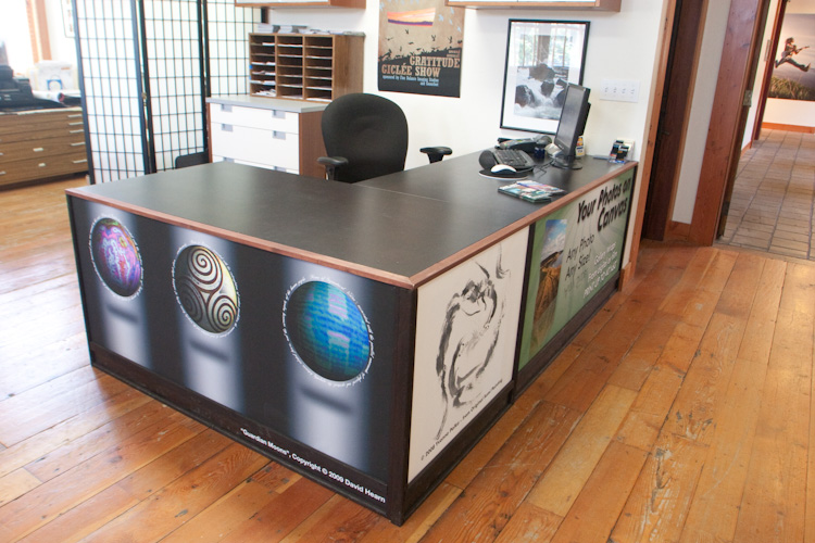 Fine Balance Imaging Studios uses changeable panels in their desks to exhibit their clients' art and promote their own services. (www.fbistudios.com)