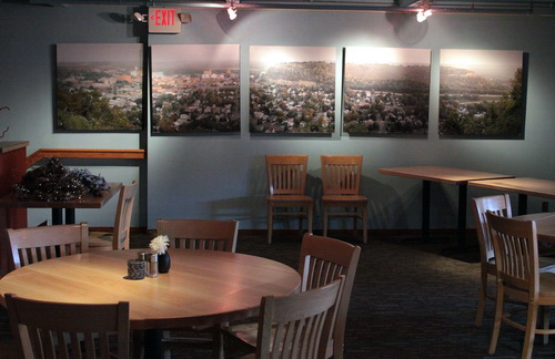 "To add a focal point to the banquet room of Norton's Restaurant in Red Wing, Becker created a five-panel panorama shot of the town. Each 40 x 40 in. panel is printed on LexJet Sunset Photo eSatin and mounted on hardboard with a reverse frame standoff. ""The image on the far left was deliberately put on a set back wall to create visual interest,"" explains Becker."