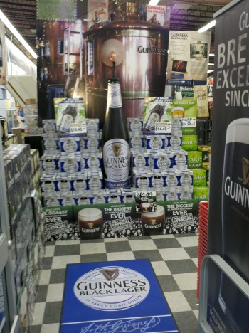 Point of sale display with pouring beer and inkjet printed graphics