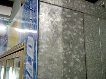 This galvanized cooler surface was tough to stick graphics to, so Coco Beverage, Hot Springs, Ark., used LexJet Foam Tape to ensure a solid bond for this point of sale project. Photo by Cameron Biles