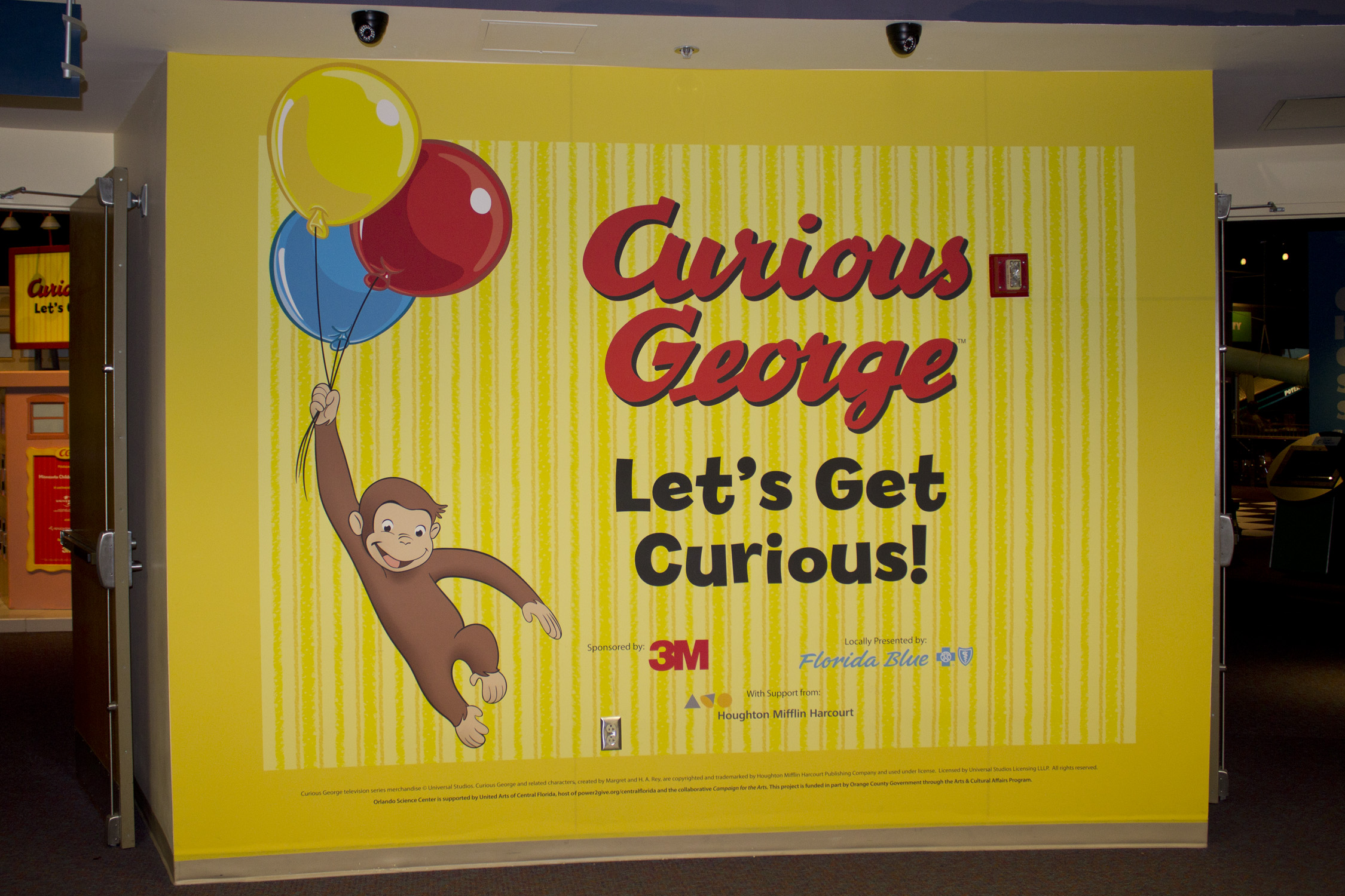 Getting the most out of wall spaces with print n stick for Curious george mural