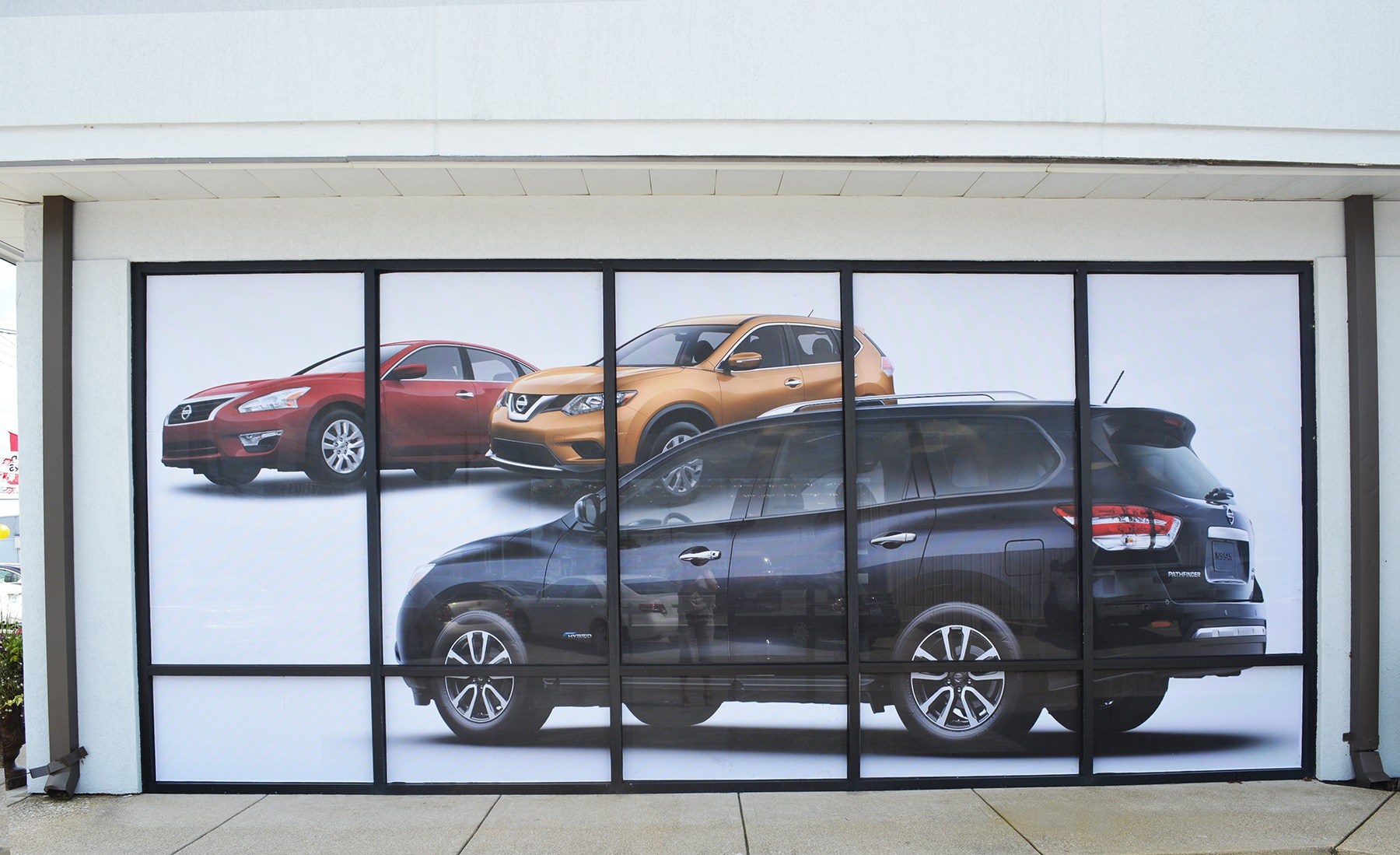 Operation curb appeal with perforated window graphics at for Window graphics