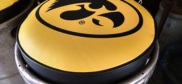 There are many uses for a beer keg, but did you know you could turn it into a custom bar stool? That's exactly what Kent Foster, owner of Fostergraphs and SportBrands, recently did for a customer loyal to the Iowa Hawkeyes.