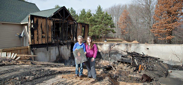 A high-school senior portrait of Shelley Bigelow's daughter, Blakely, rose from the ashes to greet her as she surveyed the scene of her home just devastated by a raging five-alarm fire near Manton, Mich. It was just about the only item that survived the fire. Fortunately, no one was hurt.