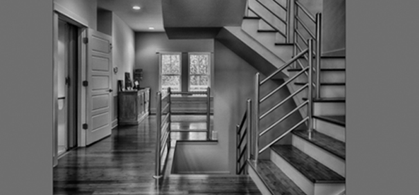 """Sometimes the most dramatic photographs can be made in the blink of an eye. When North Carolina portrait, landscape and architectural photographer Gordon Kreplin toured a local Parade of Homes event, he set up a few lights and took one shot while the hallway was clear. That one shot, named """"Upstairs Downstairs,"""" won Kreplin the 2015 Virginia Professional Photographers Association's print competition."""