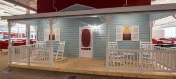 The Dollhouse's exterior is visible from the office's cubicles.